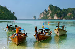 Longtail boats anchored at Ao Loh Dalum beach on Phi Phi Don Isl. And, Krabi Province, Thailand. Koh Phi Phi Don is part of a marine national park Stock Photo