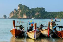 Longtail boats anchored at Ao Loh Dalum beach on Phi Phi Don Isl. And, Krabi Province, Thailand. Koh Phi Phi Don is part of a marine national park Stock Image