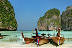 Longtail boats anchored at Maya Bay on Phi Phi Leh Island, Krabi Province, Thailand. It is part of Mu Ko Phi Phi National Park royalty free stock image