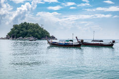 Longtail boats anchored on the sea. In lipe island Royalty Free Stock Images