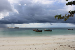 Longtail boats lined up before a storm Stock Photography