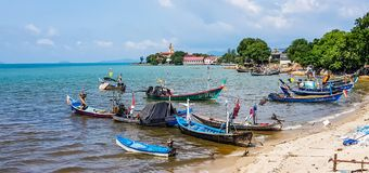 Longtail boats. Longtail boat at Bangrak pier with Big buddha background in Koh Samui,Thailand royalty free stock image