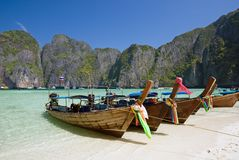 Longtail boats in the Maya bay. Traditional longtail boats in the famous Maya bay of Phi-phi Leh island, Krabi province, Thailand Stock Photo