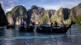 Longtail boats at Maya Bay Ko PhiPhi. Ko Phi Phi Leh Island, Thailand on November 17, 2016: Longtail boats waiting for passengers at the beach at Maya Bay Stock Photos