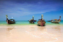 Longtail boats moored by the shore of Thailand Royalty Free Stock Images