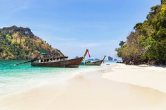 Longtail boats mooring on the beach between small limestone islands in andaman sea Royalty Free Stock Images