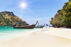 Longtail boats mooring on the beach between small limestone islands in andaman sea Thailand Royalty Free Stock Images