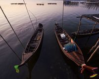 Longtail boats parking at fisherman village in Phangnga province stock photography