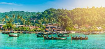Longtail boats parking in Phi Phi. Tonsai Beach bay with traditional longtail boats parking in Phi Phi island, Krabi Province, Andaman Sea,  Thailand royalty free stock photos
