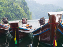 Longtail boats at the pier in Thai Stock Images