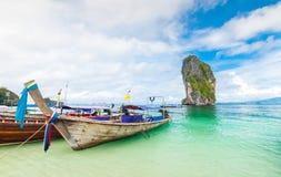 Longtail boats and poda island Stock Photos