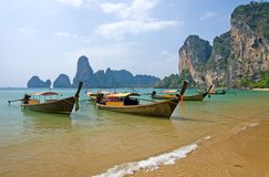 Longtail boats on the Railay beach. Traditional longtail boats on the Railay beach, Krabi province, Thailand royalty free stock image