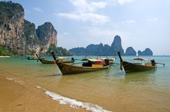 Longtail boats on the Railay beach. Traditional longtail boats on the Railay beach, Krabi province, Thailand royalty free stock photography