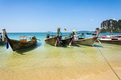 Longtail boats in Railay beach, Krabi peninsula in Thailand. Longtail boats in Railay beach on the Andaman sea water. Krabi peninsula in Thailand Stock Photo
