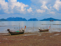 Longtail boats on shore in Thailand. Traditional wooden long tail boats ashore in Old Town, Koh Lanta, Krabi, Thailand, with the Andaman Sea and Trang province Stock Images