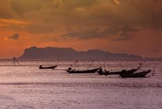 Longtail-boats during sunset in Koh Samui, Thailand royalty free stock photo