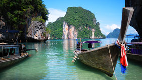 Longtail boats in Thailand. Traditional longtail boats moored on coastline of Thailand stock photo
