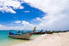 Longtail boats on a tropical island Stock Photos