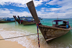 Longtail boats on a tropical island Stock Photo
