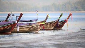 Longtail boats waiting passengers at Nopparat Thara beach stock footage