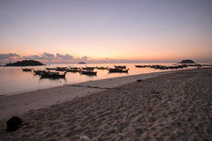 Longtail local boat on the beach at sunset. Royalty Free Stock Images