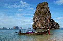 Longtail and rocks, Thailand Royalty Free Stock Photography