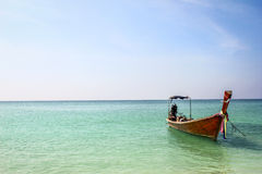 Longtailboat in calm blue sea Royalty Free Stock Photos