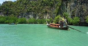 Longtailboat in lagoon Stock Image