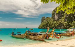 Longtail in Krabi. Longtails in A beautiful beach in Krabi royalty free stock image