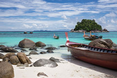Longtails on Sunrise beach, island Lipe, Thailand. Royalty Free Stock Photography