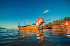 Longtale boat at the Thai beach. Paradice sand beach place. Boats on the clear water and blue sunrise sky. Longtale boat at the Thai beach. Paradice sand beach Stock Photography