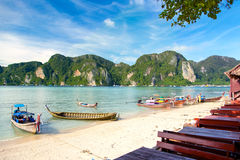 Longtale boats at the beautiful beach next to cafe. Thailand. Phi-Phi Royalty Free Stock Photo