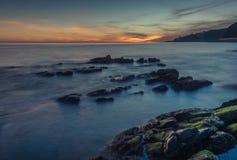 Longue exposition de coucher du soleil gentil photos stock