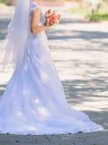 Longue queue de robe de mariage Photographie stock libre de droits