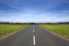 Longue route Photos libres de droits