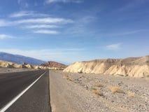 Longue route de désert Photo libre de droits