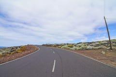 Longue route isolée Photos libres de droits