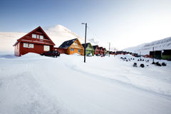 Longyearbyen. A detail of Longyearbyen, Svalbard, Norway.  A row of houses and a mountain in the distance Stock Images