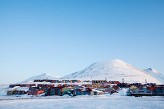 Longyearbyen. A detail of Longyearbyen, Svalbard, Norway.  A row of houses and a mountain in the distance Stock Image