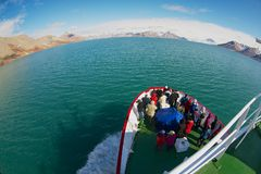 Tourists enjoy the arctic polar sea views from the cruise ship in Longyearbyen, Norway. stock photography