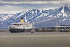 LONGYEARBYEN, SVALBARD, NORWAY - JULY 12 2014: Tourists boarding stock photos