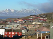 Longyearbyen town. Scenic view of Longyearbyen town with mountains in background, Svalbard, Spitsbergen, Norway Royalty Free Stock Image
