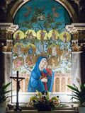 Altar dedicated to the Virgin Mary depicted in a colorful mosaic. Lonigo, Italy - August 8, 2017: Altar dedicated to the Virgin Mary depicted in a colorful Royalty Free Stock Photos