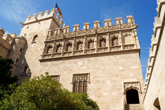Lonja de la seda of Valencia. In Spain and the valencian flag. View from the garden. This small complex of late gothic buildings, originally was used to trade Royalty Free Stock Photo
