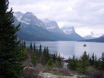 Lonley Island. Small island in lake at Glacier National Park stock image