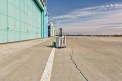 Lonley luggage on the runway stock photography