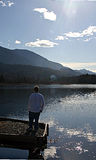 Lonley man. Man looking out to beautiful scenery royalty free stock photography