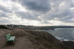 Lonely Bench Sea Shore Cloudy Stock Photography