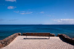 Lonly empty bench in playa blanca Stock Image