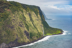 Lonokiokio Gulch with distant bad weather. View taken from the Waipio lookout at Honokaa. The distant rain washes out the colors stock photo